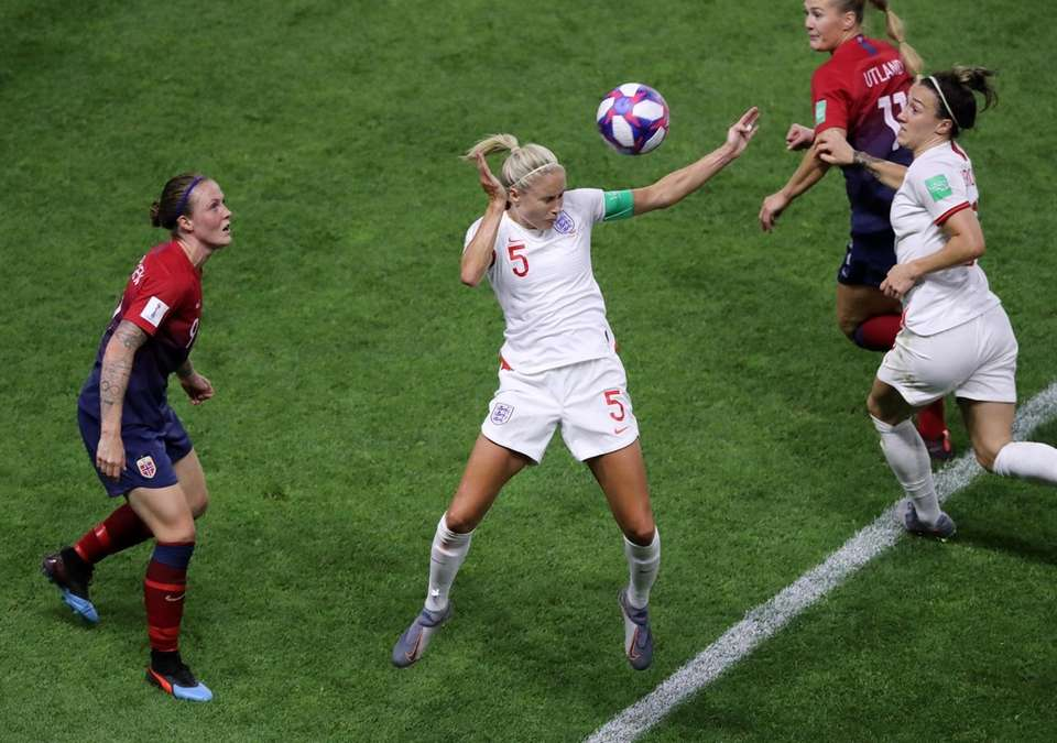 Steph Houghton of England heads the ball during