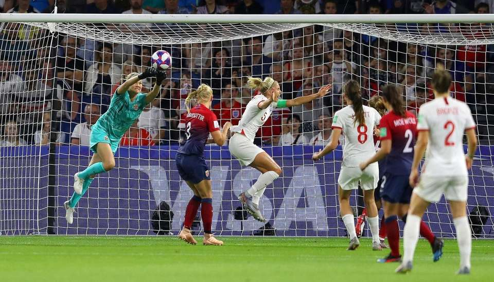 Steph Houghton of England is fouled by Maria