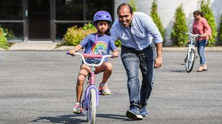 Anya Shah, 7, of Woodbury, learns to ride