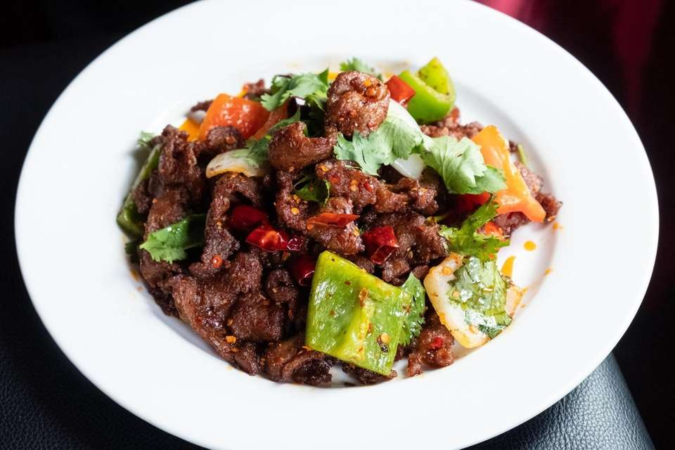 Cumin lamb with chilis, bell pepper and cilantro