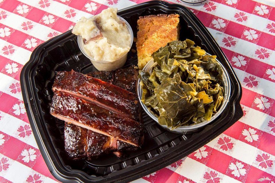 Rib platter with collard greens, garlic mashed potatoes