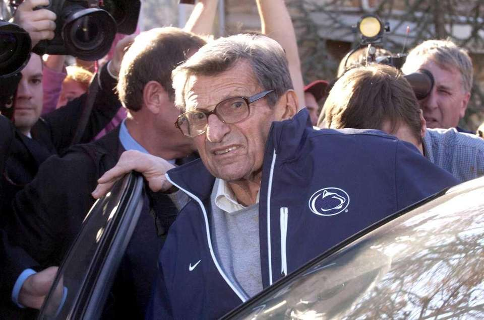Penn State football coach Joe Paterno gets into