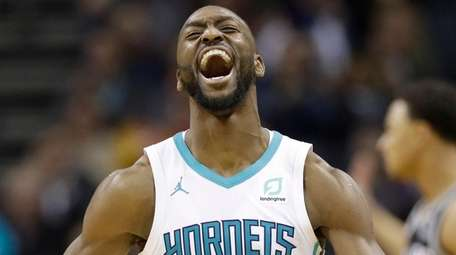 Hornets guard Kemba Walker reacts after making a