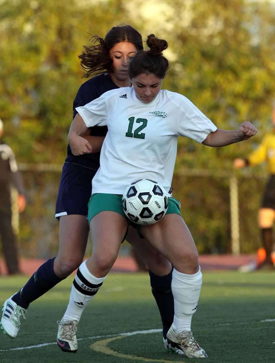 Carle Place's Athena Coras in control during the