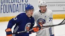 New York Islanders defenseman Robin Salo, left, skates