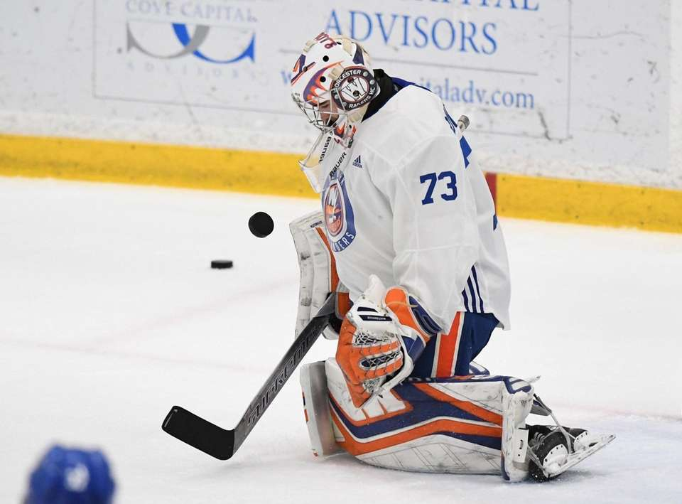 New York Islanders goalie Evan Buitenhuis warms up