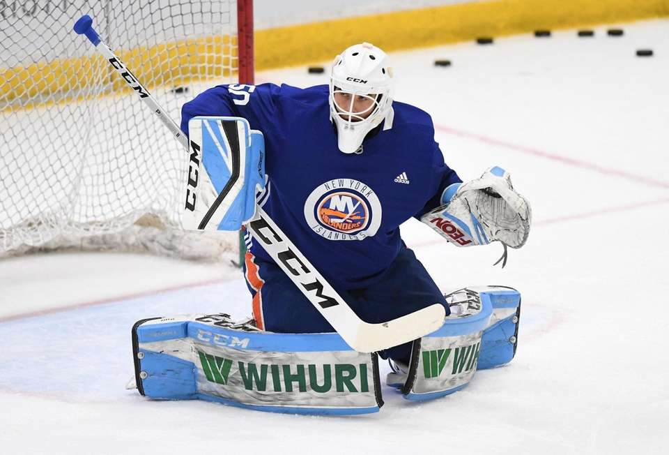 New York Islanders goalie Jakub Skarek warms up