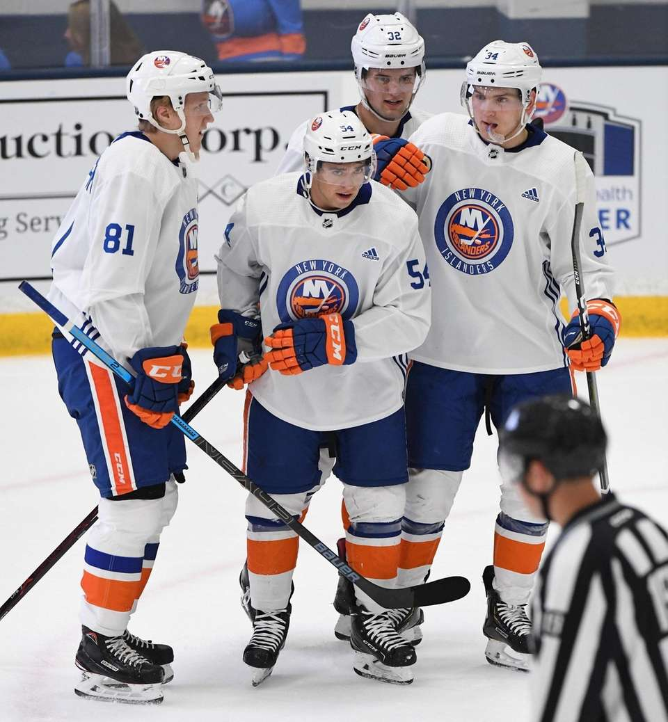 New York Islanders Mason Jobst (54) is congratulated