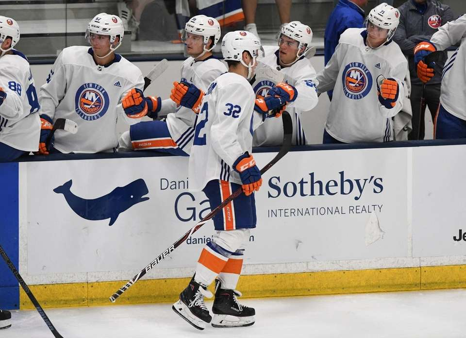 New York Islanders forward Oliver Wahlstrom is congratulated