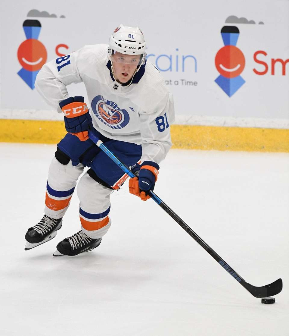 New York Islanders forward Simon Holmstrom skates with