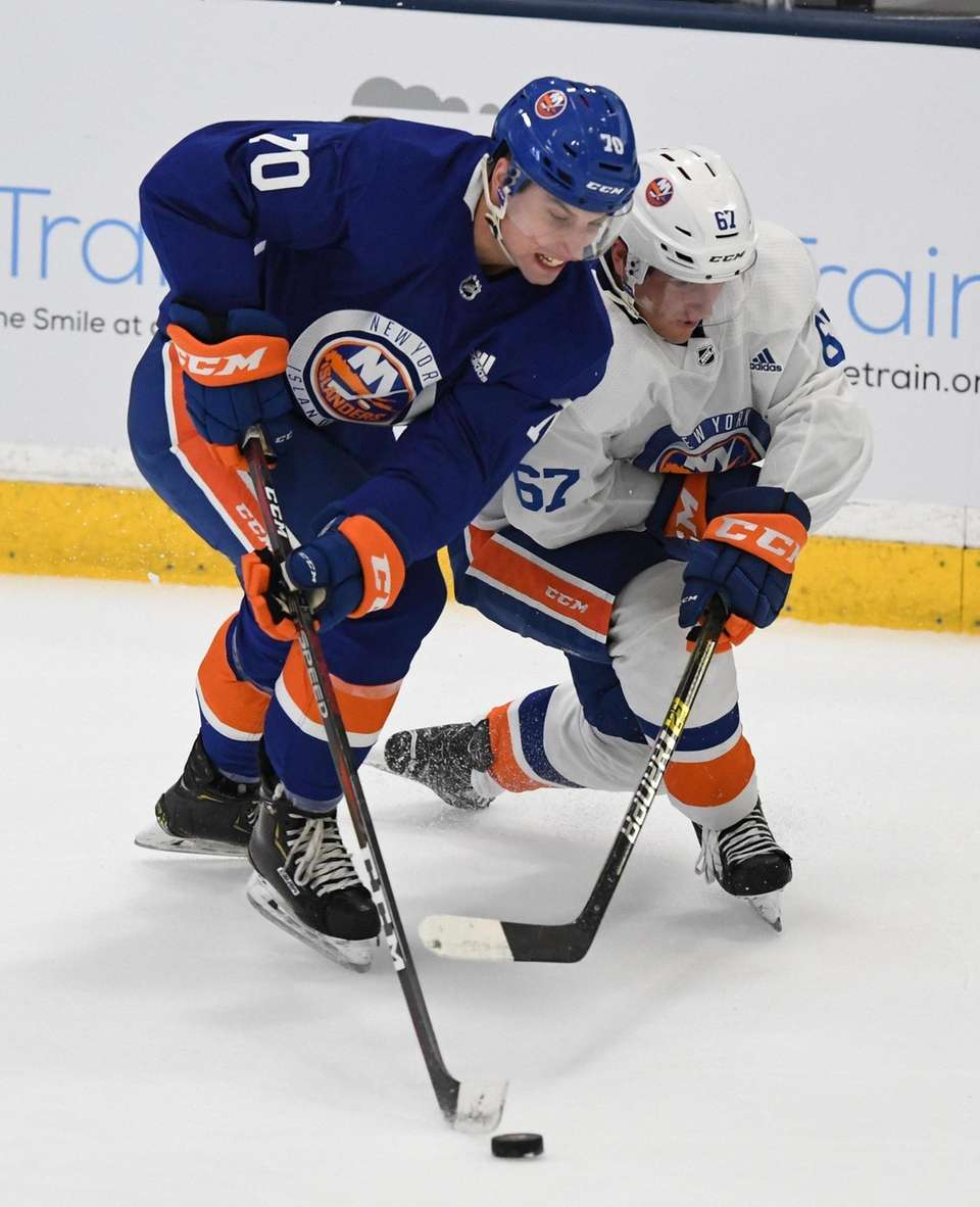 New York Islanders forward Erik Brown, left, skates