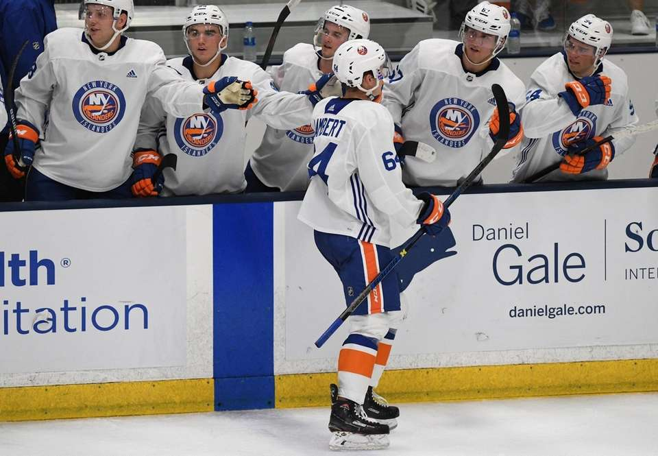 New York Islanders forward Jimmy Lambert is congratulated
