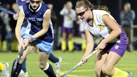 Rocky Point F Maggie DeFrank #3, tries to