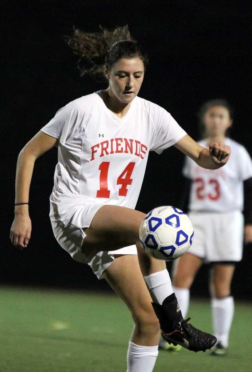 Friends Academy's Marissa Tidona controls ball during the