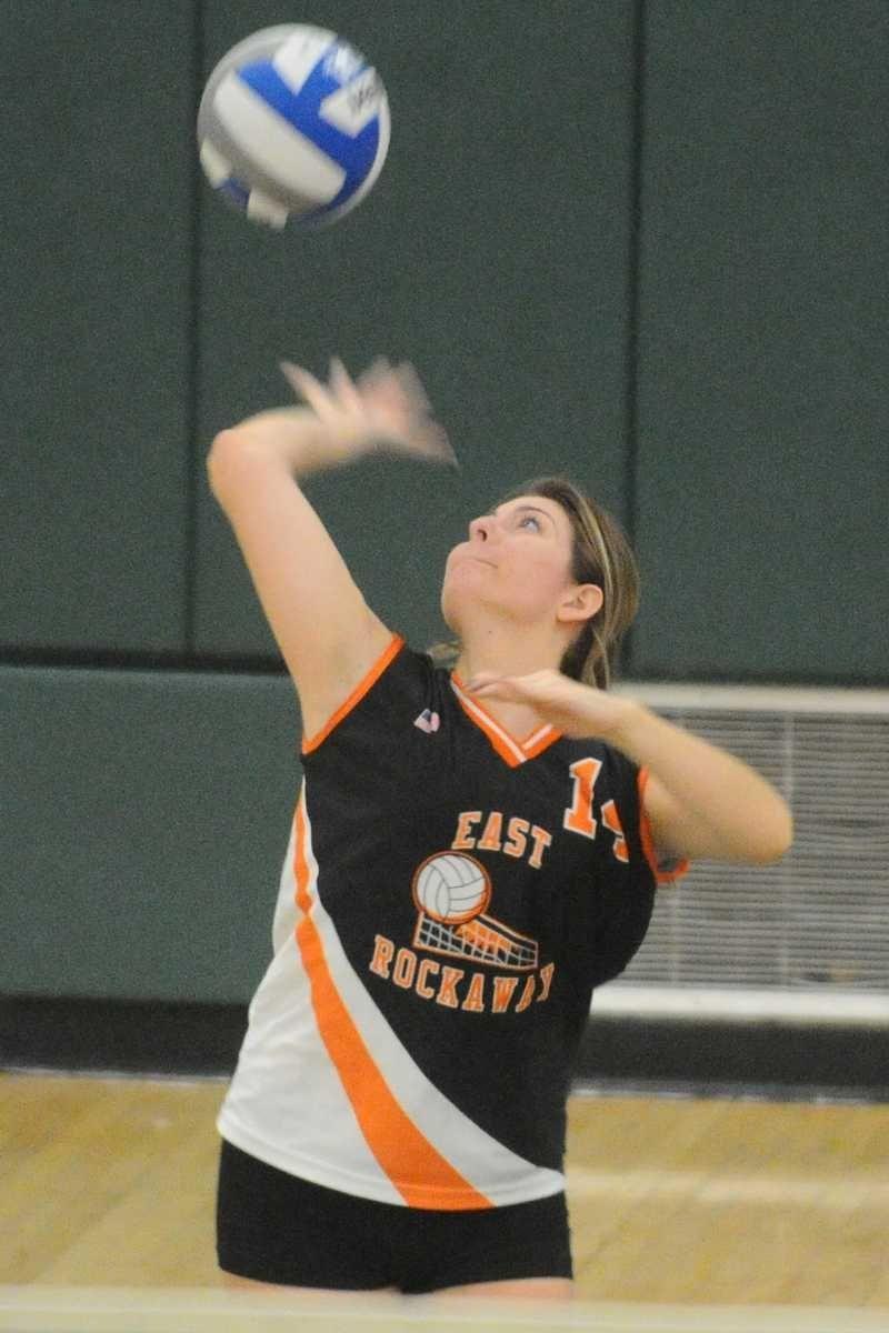 East Rockaway High School #14 Sarah Reid serves