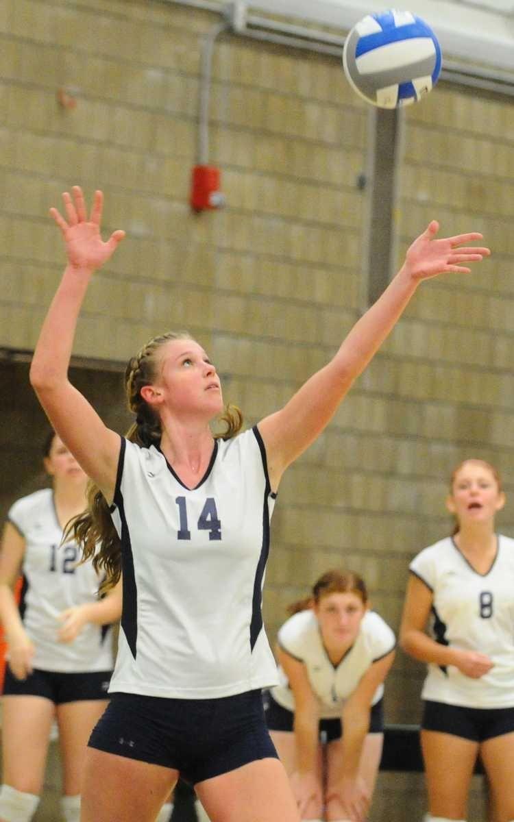 Massapequa High School #14 Lauren Van Buren serves