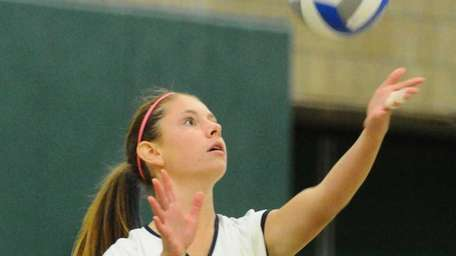 Massapequa High School #8 Samantha DePasquale serves a