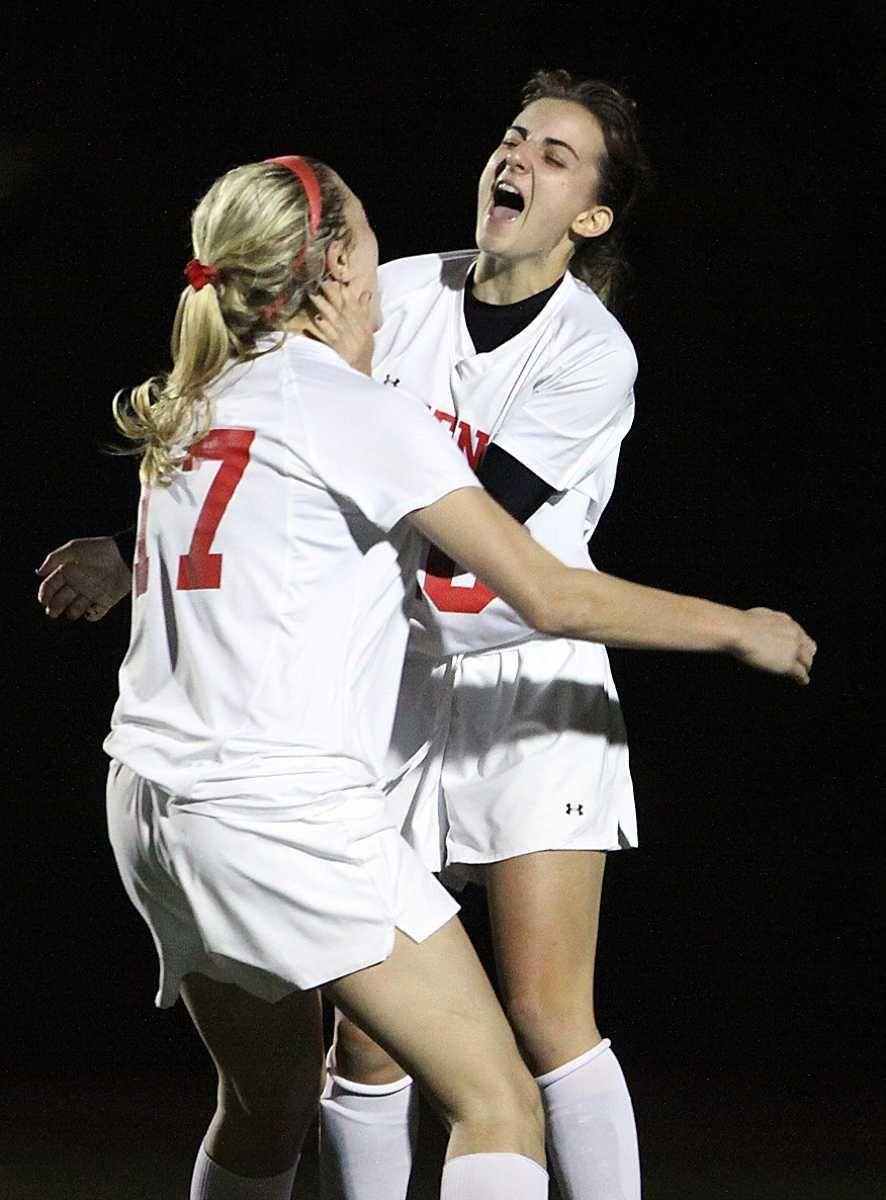 Friends Academy's Jamie Genatt (right) celebrates scoring her