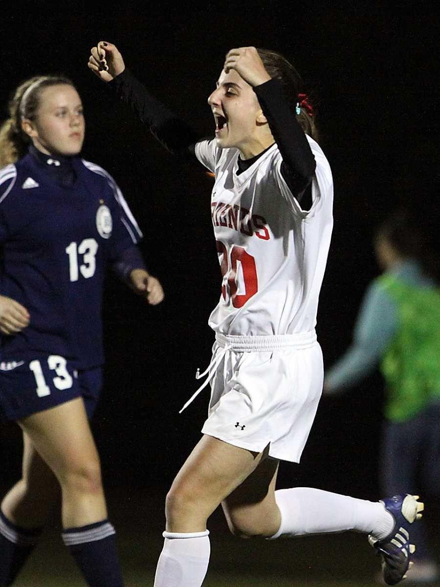 Friends Academy's Jamie Genatt celebrates scoring her second