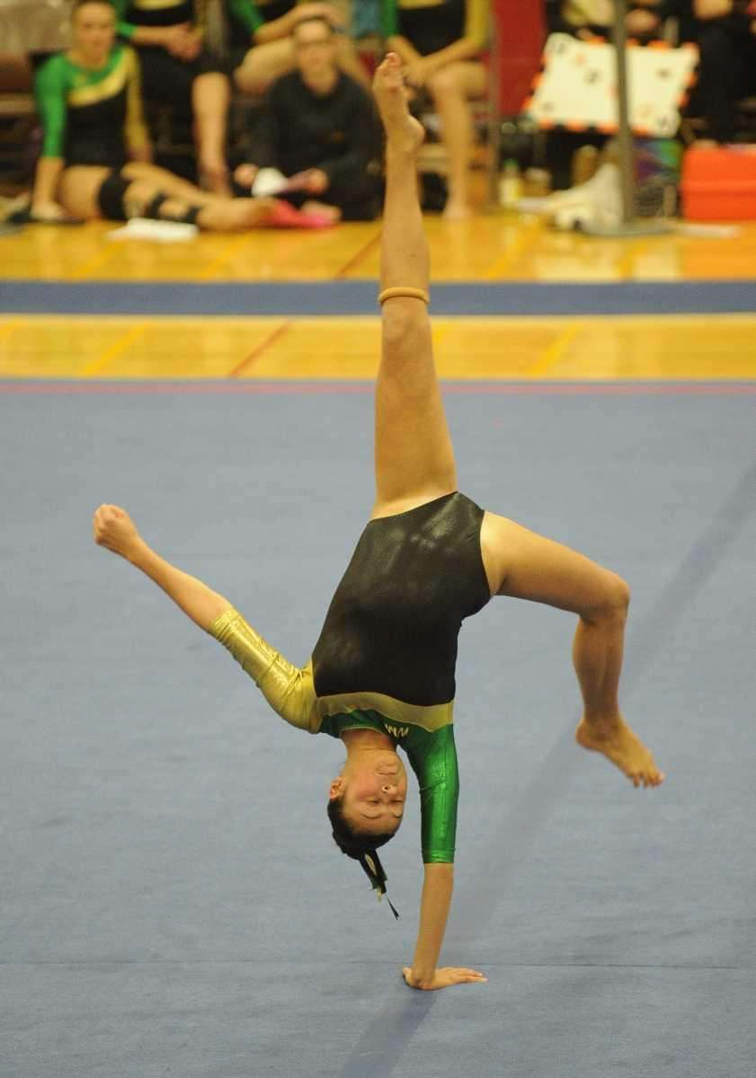 A Ward Melville gymnast performs during the floor