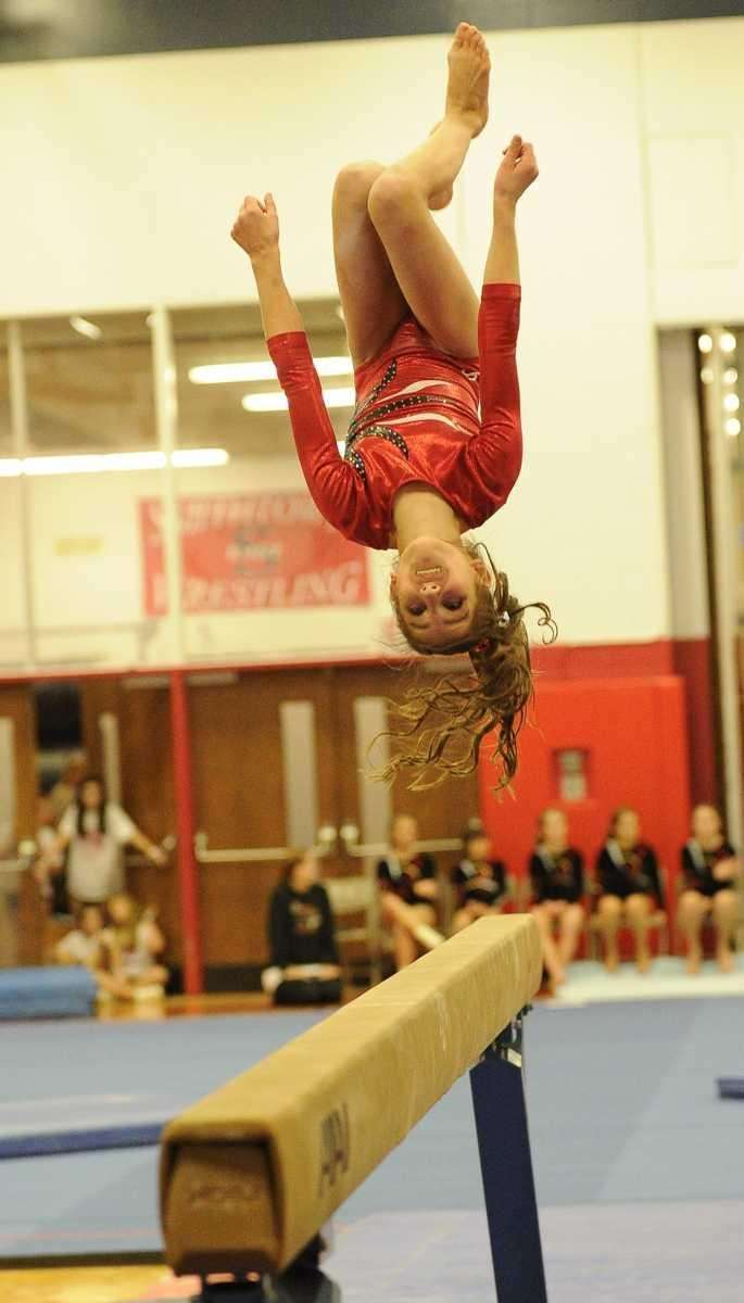 Half Hollow Hill's Jordan Ceccarini dismounts from the