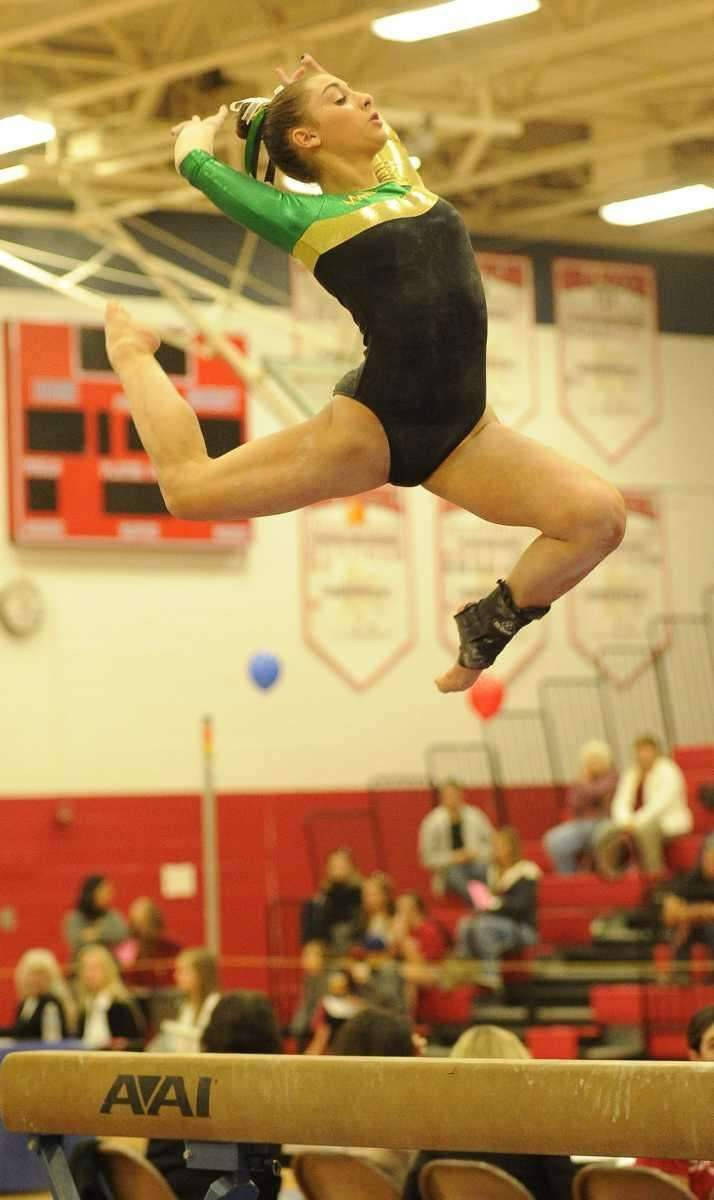 Ward Melville's Alison LaRocca competes above the balance