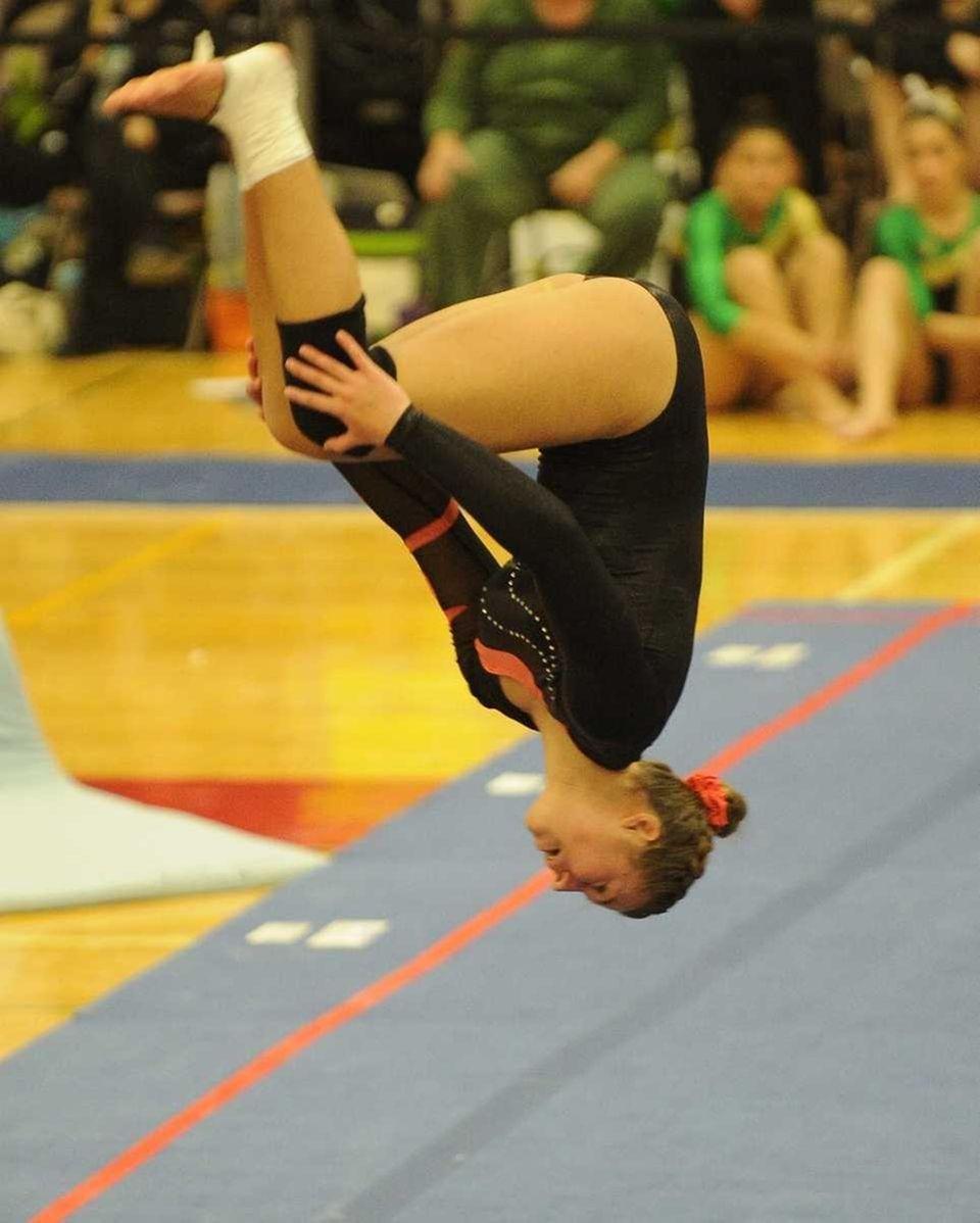 Babylon's Mikalia Hartigan performs during the floor exercise