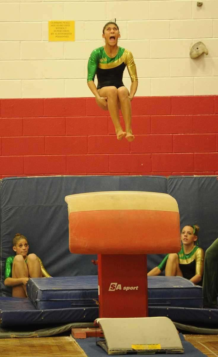 Ward Melville's Taja Slade performs on the vault