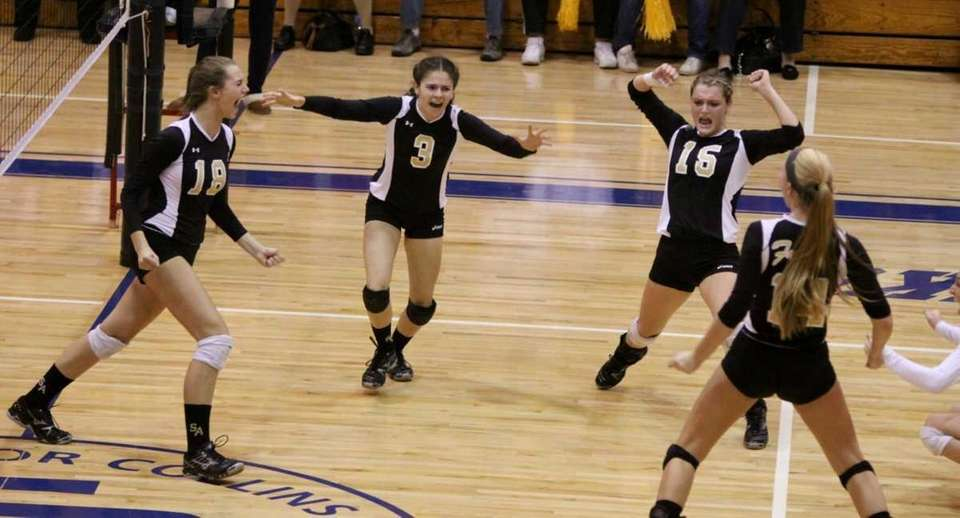 St. Anthony's celebrates a point over Kellenberg during