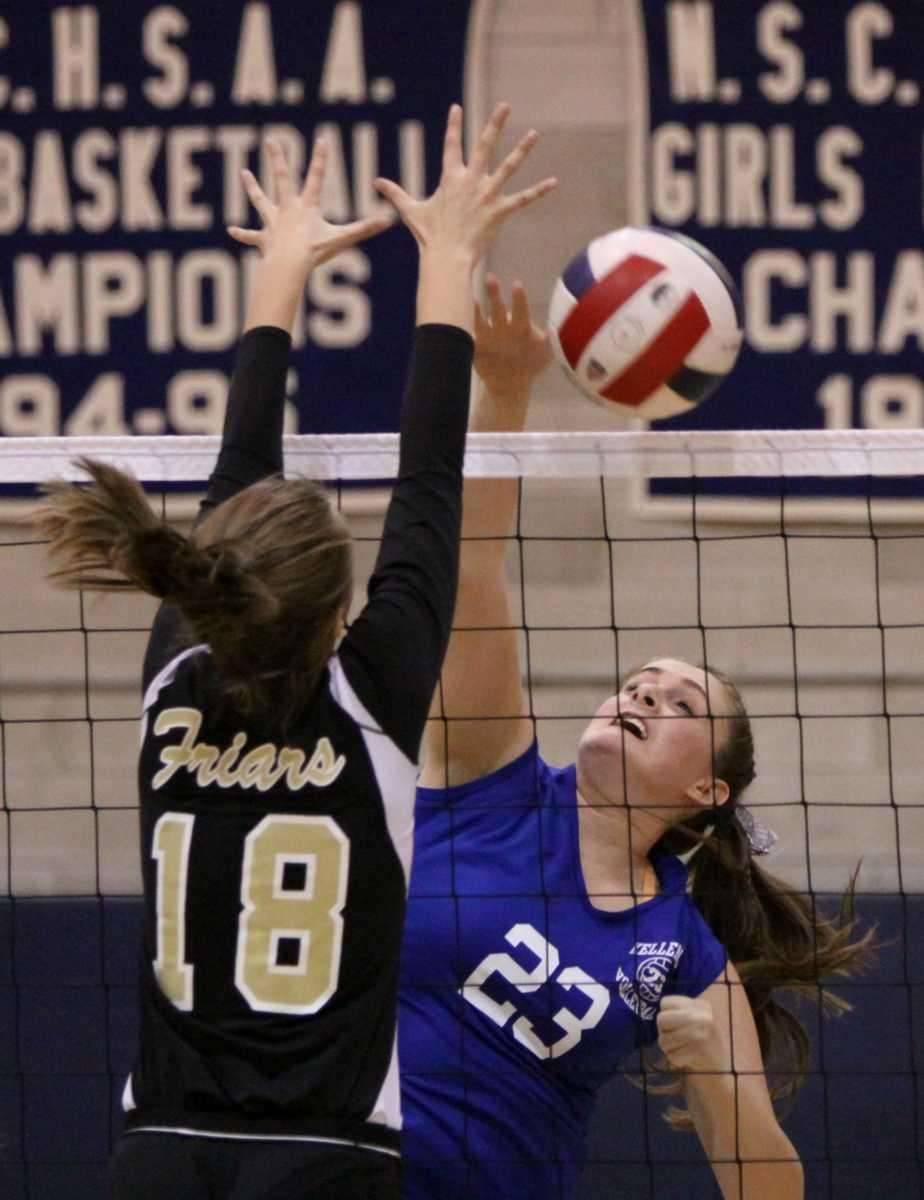 Kellenberg's Candace Belvedere, right, spikes the ball past