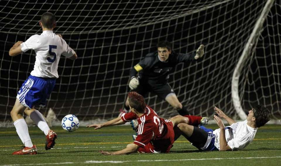 Wheatley's Jonathan Kowlaczyk's (21) sliding shot on goal