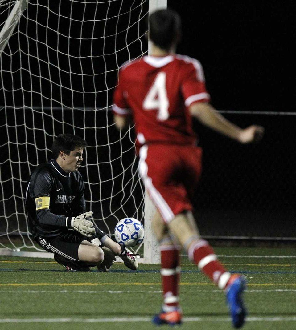 Mattituck's keeper Austin Scoggin with the save in