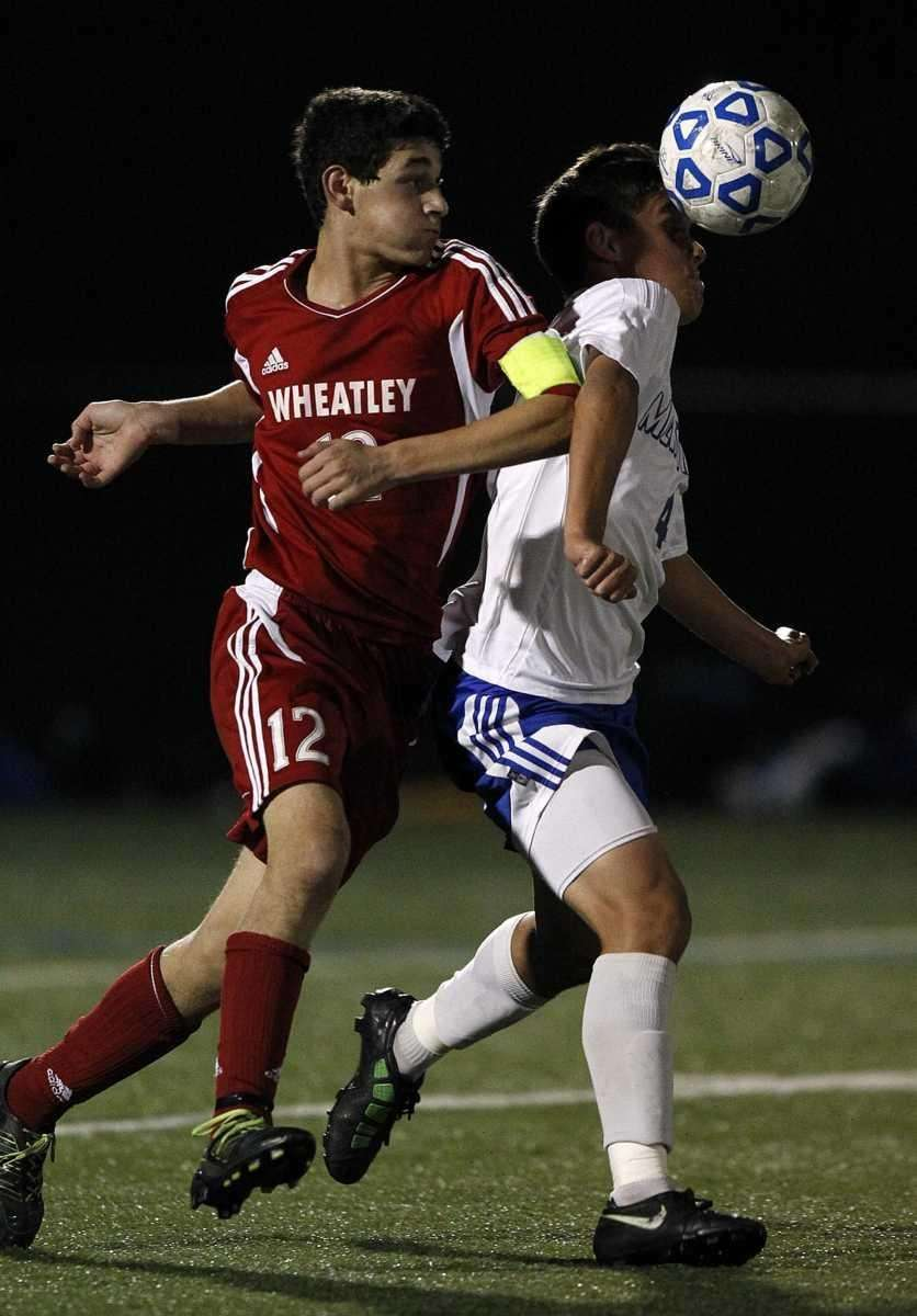 Wheatley's Alex Butwin (12) and Mattituck's Jame Hayes