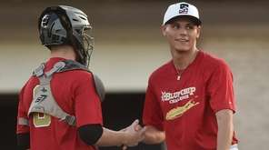 Josh McGee, Connetquot catcher, left, and pitcher Brian