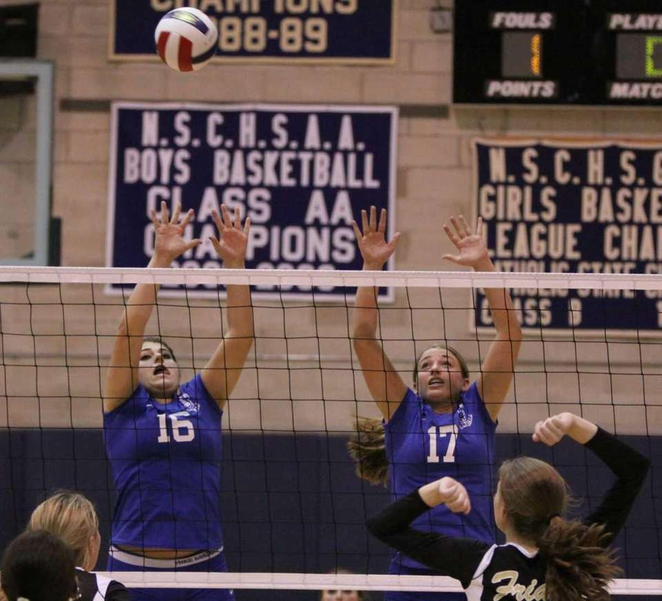 Kellenberg's Jennifer Bollet, left, and Brianna Capobianco defend