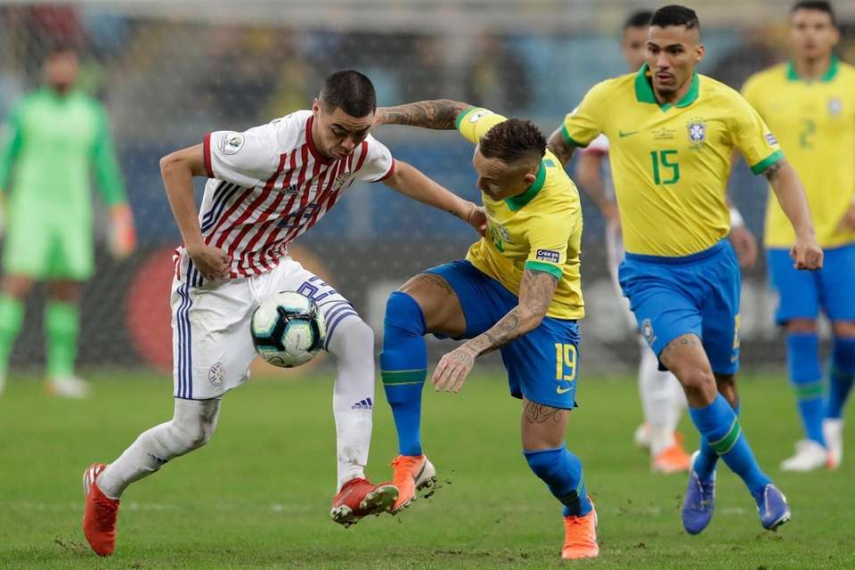 Paraguay's Miguel Almiron, left, vies for the ball