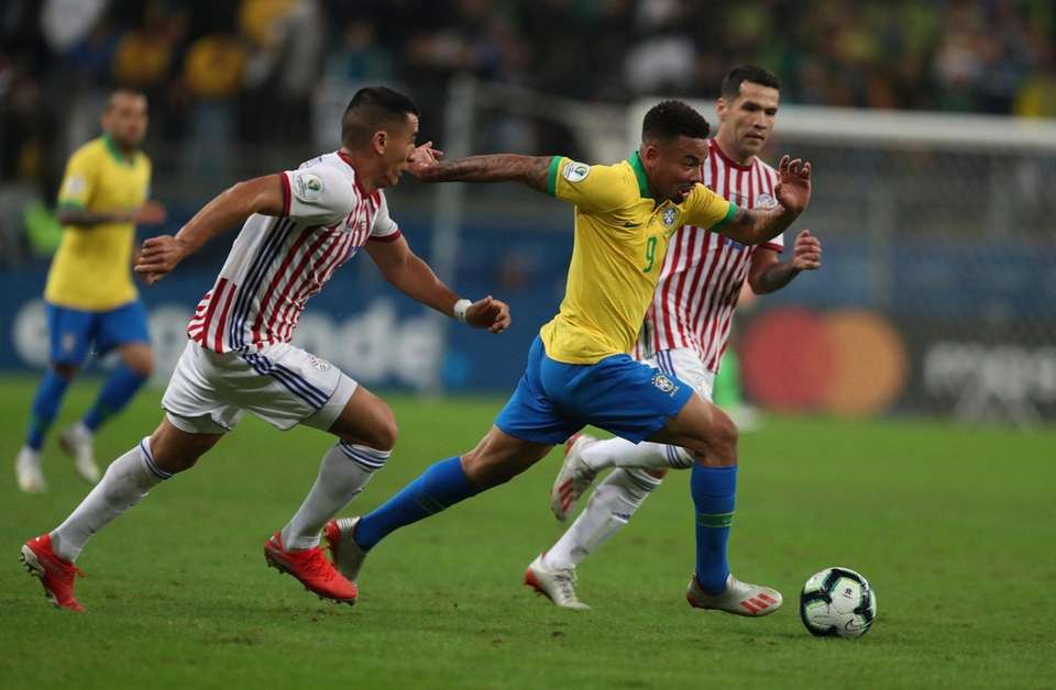 Brazil's Gabriel Jesus, right, controls the ball during