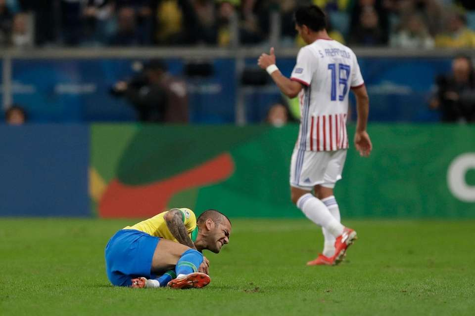 Brazil's Dani Alves reacts after being fouled by