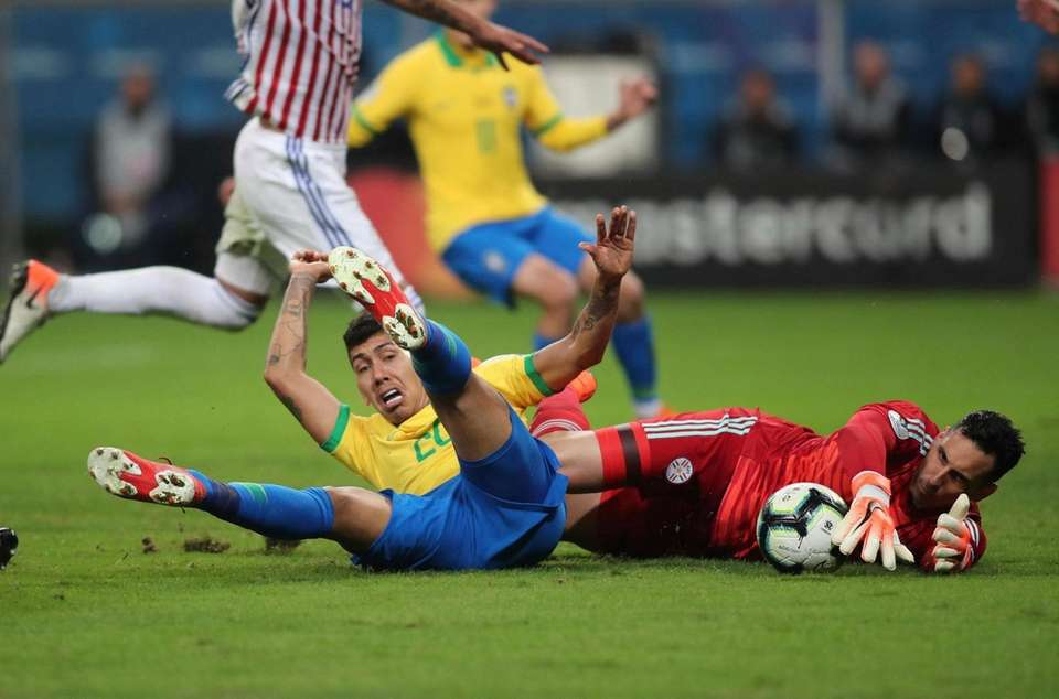 Paraguay's Junior Fernandez, right, catches the ball as