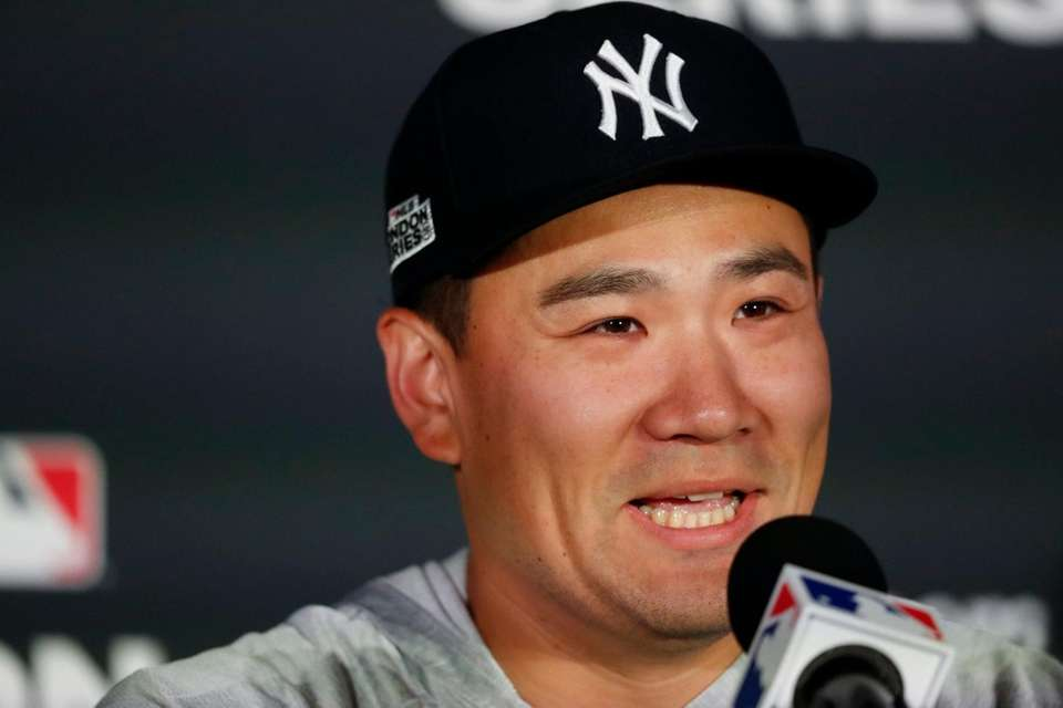 Yankees starting pitcher Masahiro Tanaka speaks to the