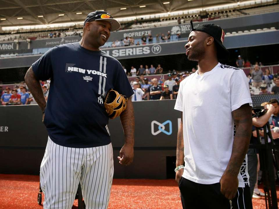 Yankees starting pitcher CC Sabathia, left, talks with