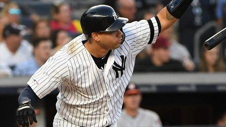 Yankees catcher Gary Sanchez drops his bat on