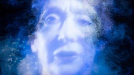 "Tony Oursler's ""Phase / trans,"" a projection with"