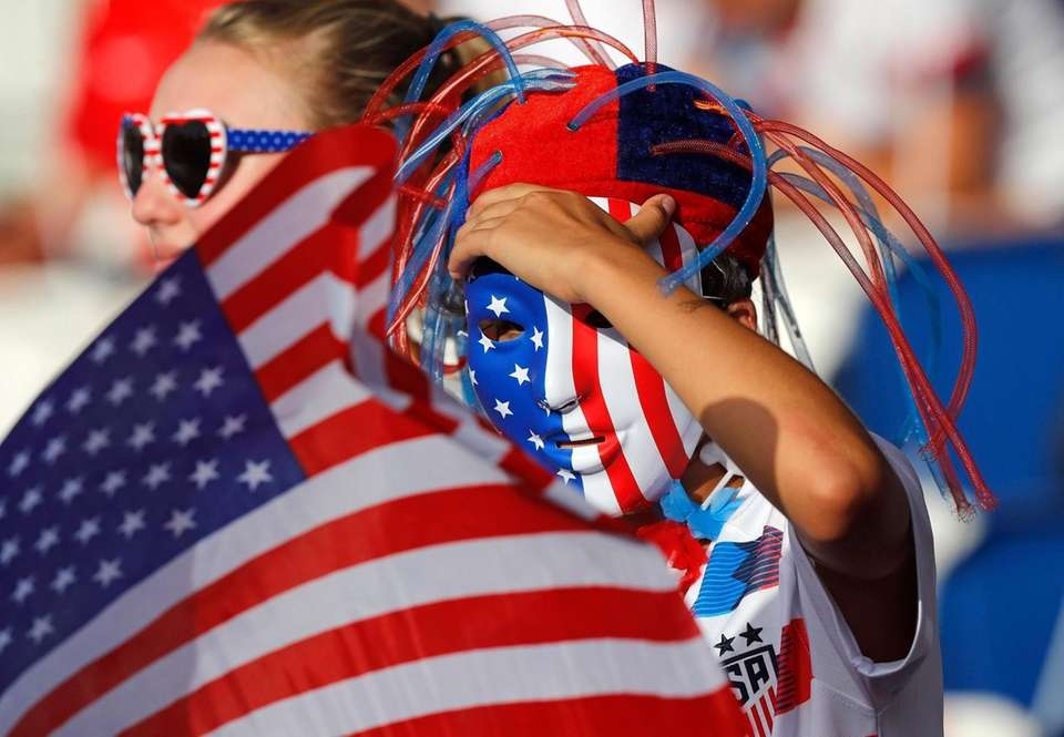U.S. supporters wait for the start of the