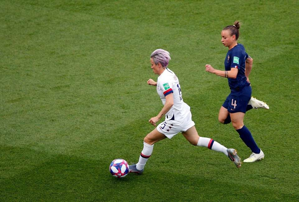 United States' Megan Rapinoe, left, and France's Marion