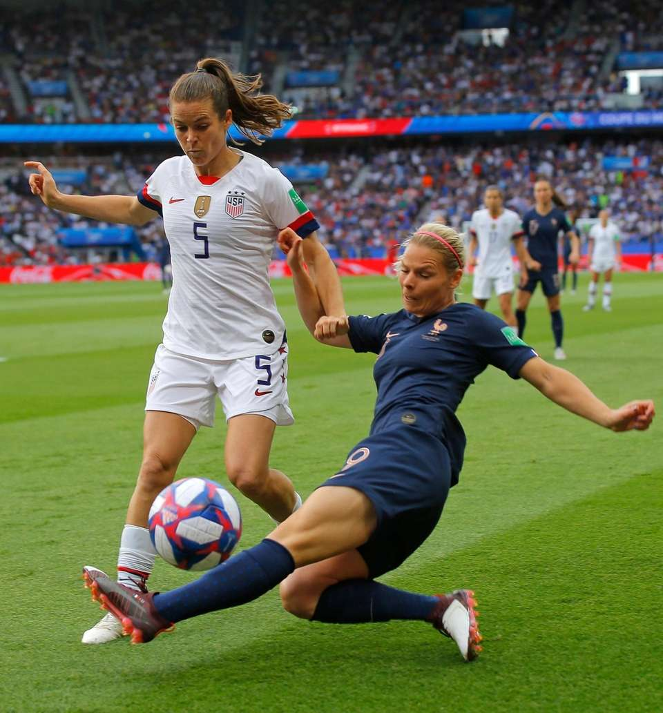 United States' Kelley O Hara, left, is challenged