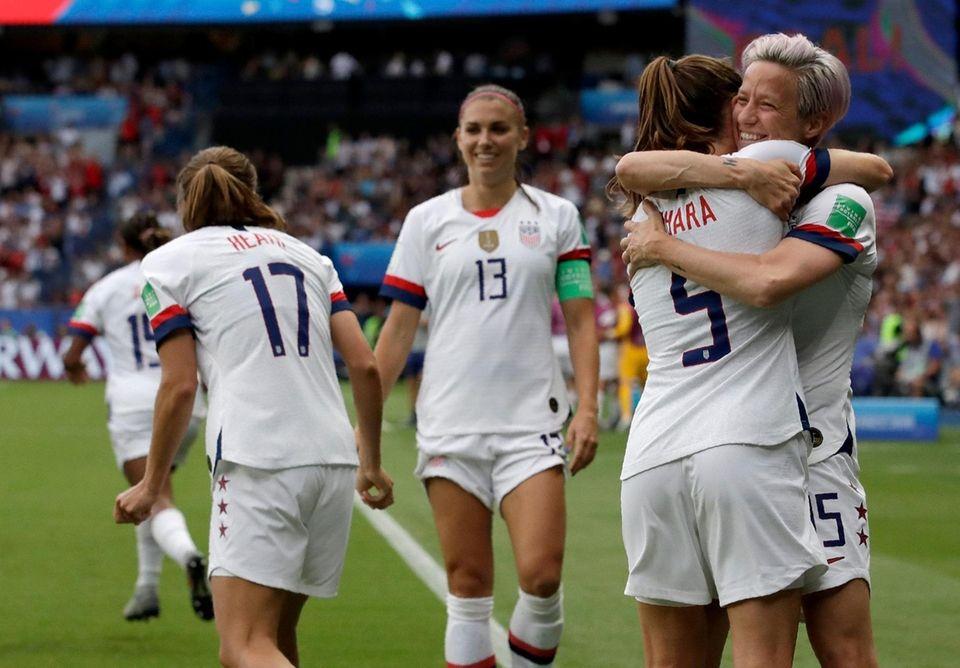 United States' Megan Rapinoe, right, celebrates with teammates