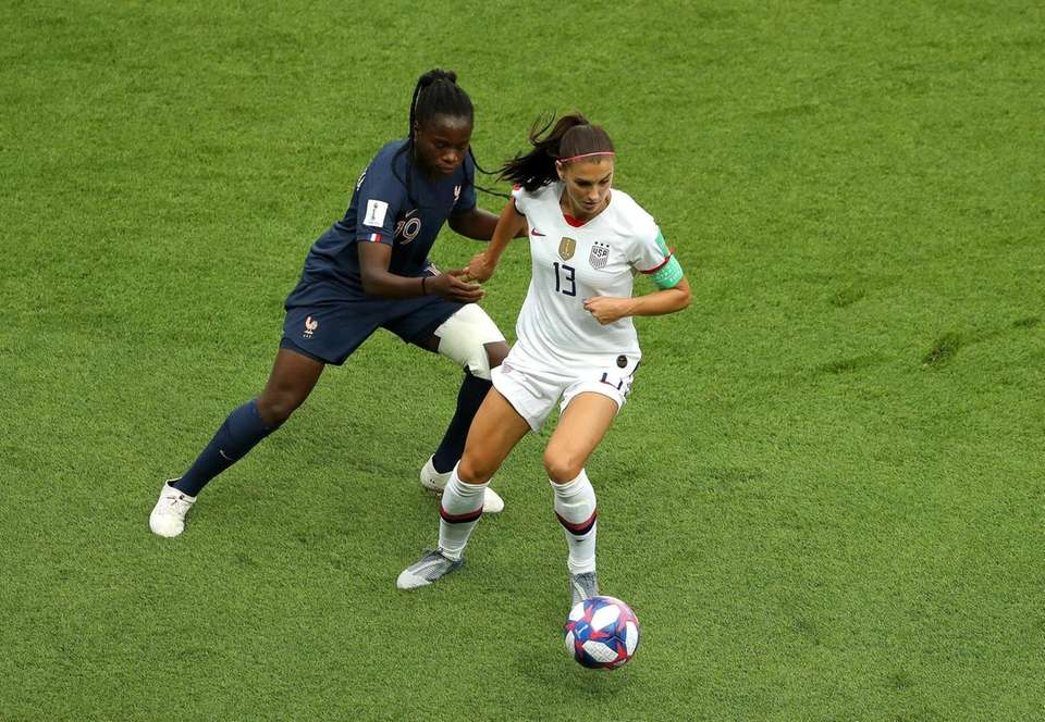 Alex Morgan of the USA battles for possession