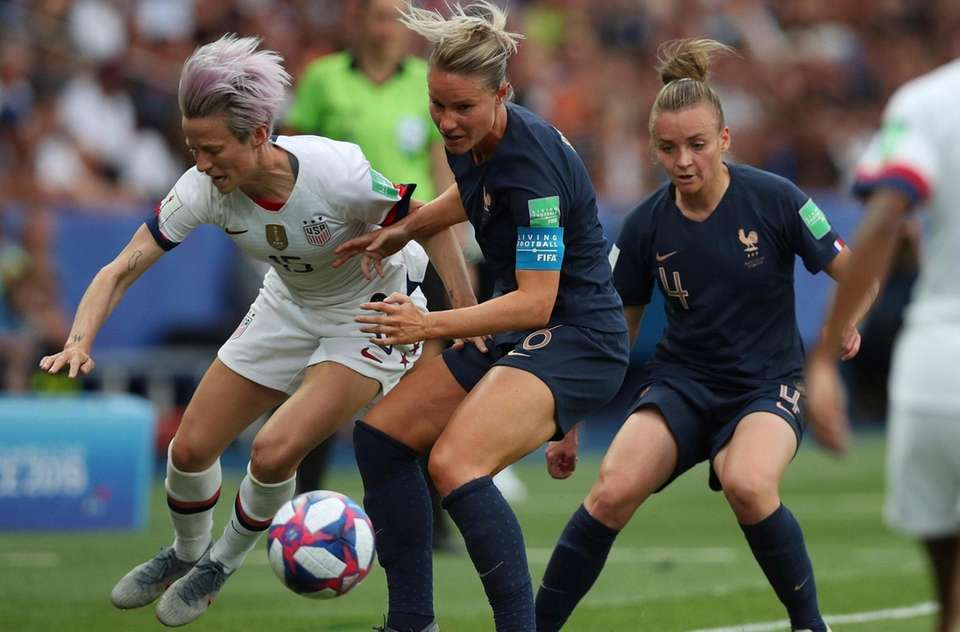 United States' Megan Rapinoe, left, vies for the