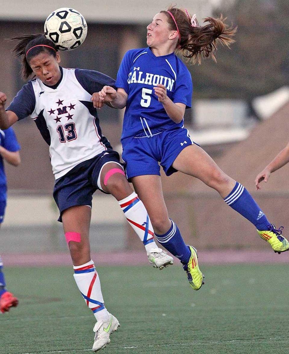 MacArthur's Kristyn Alonzo heads against Calhoun's Jessica Foley